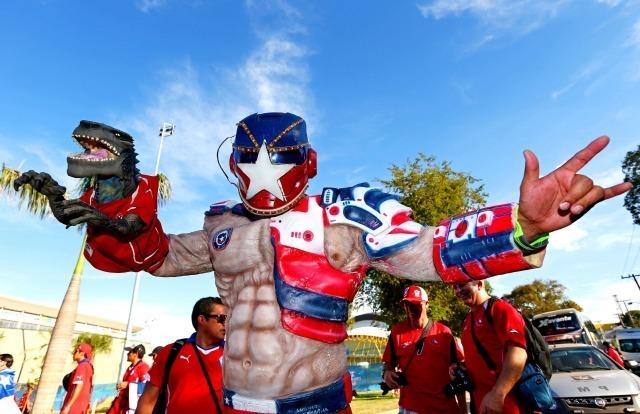 Serait-il le fan plus intimidant du Chili ? Photo prise avant le match Chili Australie devant le stade Arena Pantanal le 13 juin 2014. ©Photo by Clive Brunskill/Getty Images