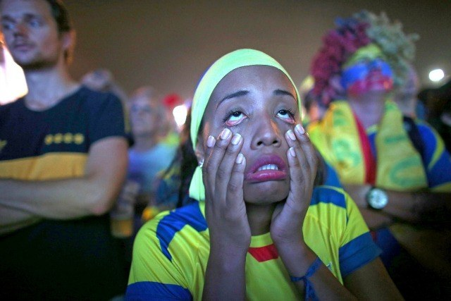 Réaction d'une supportrice de l'Equateur sur la plage de Copacabana lors d'un match de l'Honduras le 20 juin 2014. ©Photo by Joe Raedle/Getty Images